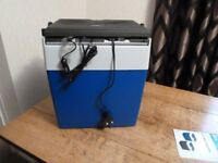 Electric coolbox, works off mains or 12V. New condition, unused.