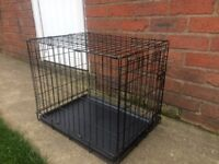 BRAND NEW SMALL DOG CRATE , 24 INCHES LONG, 17 INCHES WIDE AND 20 INCHES TALL