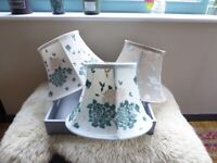 Three embroidered cotton lampshades