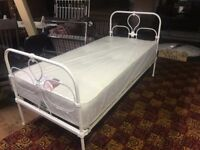 Single bed complete with new mattress. Antique iron.