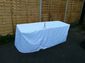 2 x 6ft fitted table covers in immaculate condition, used once at a wedding. easily ironed!