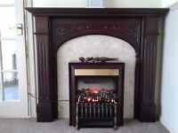 Mahogany fireplace and electric fire .marble background