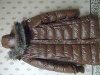100 % original Monculer brown jacket size small ( Long-tall )
