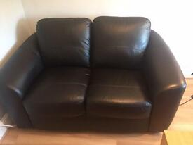 Black leather two seater sofa for sale.