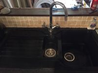 Black sink and taps