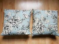Pair of blue floral cushions