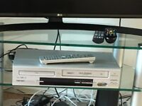 Hitaci DVD and Video player with 4 dvd's And 7 videos