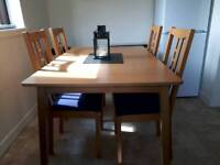 Extendable kitchen table and with six chairs