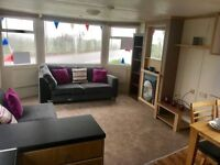 Cheap 3 bedroom 12ft caravan by the sea - not kent, low running costs!