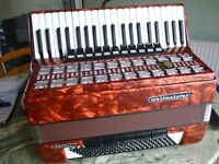 beautiful full size 120 key bass weltmiester accordian,has various tone changing cuplets,lovely red.