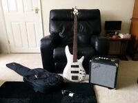 SR300-PW Powder White Bass Guitar including Stagg gig bag with a Fender Rumble 15 bass amplifier.
