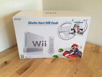 White Nintendo Wii with Mario Kart Pack – Like New