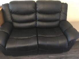 Nearly new recliner leather sofa 3 seater and 2 seater in good condition