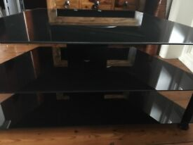 Black glass TV/DVD Stand. 3 tier. Sturdy build. Excellent condition. Buyer collects.