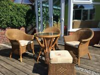 3 Rattan chairs, table and footstool with storage. Excellent condition