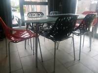 Glass dining table and 6 chairs red and black