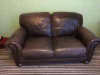 2x brown leather sofas.