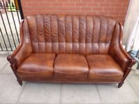 A Brown Leather Italian Chesterfield Style Three Seater Sofa