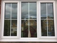 White UPVC window with white wooden blinds