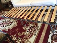 Metal Bed Frame with wood slats. Folding legs to ease storage Excellent Condition