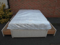 Double divan bed with 4 drawers and new mattress. Can deliver