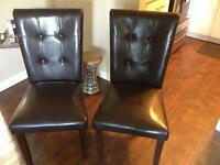 Matching faux leather dark brown chairs.