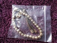 Michael Kors bracelet gold colour beads with brown piece New still in the packet