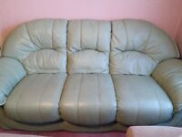 2 mint green leather sofas