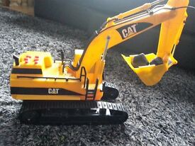 Toy Caterpillar CAT light and sound excavator, hardly used, battery operated, works perfectly-