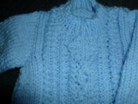Hand knitted pale blue baby aran jumper