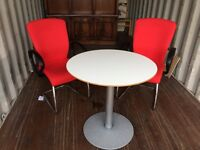 2 Red Office Chairs And Round Table. Excellent Condition. Can Deliver.