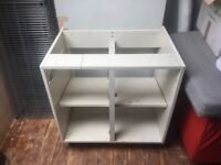 Free L- Shaped Kitchen.Cupboard base units with oak finish doors with worktop sink and mixer tap