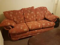 A set of 3 seater sofa and 2 singles one with foot stool