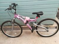Girls mountain bike. For ages 10 - 14 some small spots of rust the hand grip is torn. Working bkie