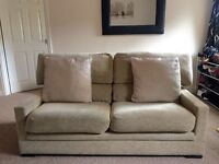 Beige 2-seater sofa with matching cushions