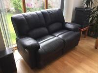 TWO matching black leather two-seater recliner sofas