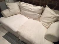 Cream three-seater sofa