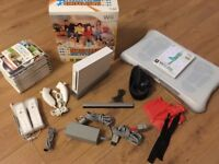 Nintendo Wii with games and loads of accessories