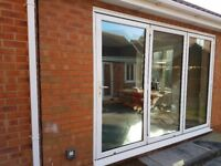 Metal framed 3 panel bi-folding doors with frame & upvc d/g window with blind