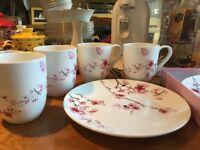 Matching mugs and cake stand