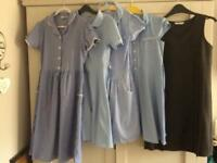 Bundle of blue gingham school dresses and pinafore