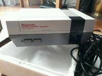 Nintendo NES Console plus Super Mario Bros and two other games