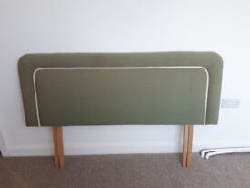 Headboard for double bed. High quality hand upholstered. Green colour with piped trim.