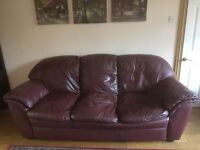 Three seater leather maroon sofa requires new home.