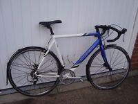 Road Bike - Carrera 58cm frame - suit 5'11'' or taller. Shimano Sora gears. 14 speed.