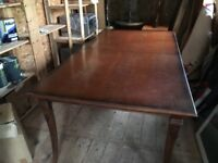 large solid mahogany dining table