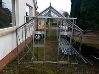 10x8 greenhouse with most glass, includes work bench and small work table
