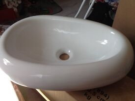 large white oval ceramic sink basin bathroom counter top
