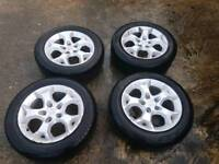 Vauxhall alloy wheels with almost new tyres