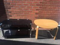 Black glass tv stand good condition. Round wooden coffee table good condition